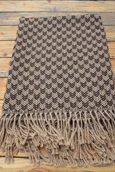 Dark Brown/Tan Chex Alpaca Throw Rich multi-textured handwoven alpaca throw. Show off the incredible feel of alpaca with this great gift.  Handwoven by our network of artisans' cooperatives in Peru.  www.purelyalpaca.com