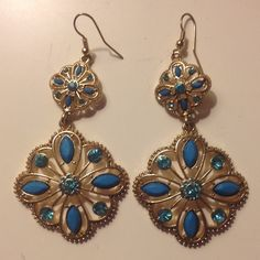 Never Used Gold and Blue Earrings Got as a gift! Brand new and never worn! Gold and Blue Dangle Earrings Jewelry Earrings