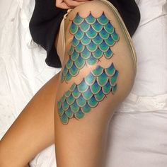 Reveal your inner mermaid with green and teal fish scales. | 32 Cool And Colorful Tattoos That Will Inspire You To Get Inked