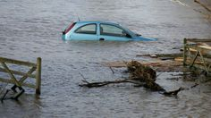 Floating Cars in Bridgwater, England A car sits in flood water on a flooded property at Burrowbridge on the Somerset Levels on Feb. 9, 2014 ...