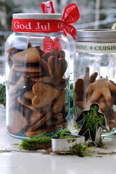 Big Mason jar filled with cookies and tied with a ribbon.