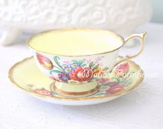 The gracious ceremony of tea never fails to bring people together.  Our lovely set features a beautiful blue floral motif on crisp white English bone china by Royal Albert.  Since 1904, the quintessentially patterns of Royal Albert china have been a hallmark of fine tableware. Through the years, Royal Albert has been dedicated to creating fine china pieces that render grace, elegance, and romance. Measures approximately: Cup: 2 7/8 tall x 4 1/2 wide (includes handle); Saucer: 5 1/2 diameter…