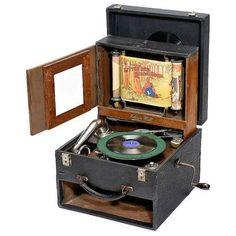 'Edison Bell Picturegram - Panorama Gramophone, 1924. Rare portable panorama gramophone with moving picture spools, made in England by 'Edison Bell Ltd., London', spring motor for both functions, removable oak-framed 'screen' stowing as a drawer during transport. Vintage Records, Vintage Toys, Edison Phonograph, Puppets For Kids, Toy Theatre, Retro Videos, Record Players, Paper Toys, Dose