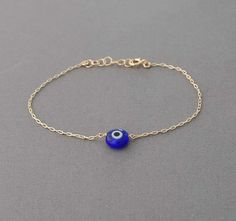 Blue glass evil eye on a delicate 14k gold fill, 14k rose gold fill, or sterling silver chain. There are different sizes for you to choose from.