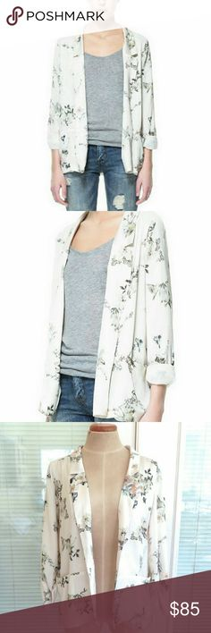 NWT Zara Ivory Floral Print Blazer Jacket. Small Zara Trafaluc ivory floral print open blazer. Made of polyester for a silky, satiny feel. Very versatile.  New with tags with no defects. Zara Jackets & Coats Blazers