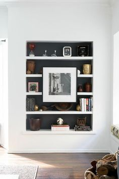beautiful recessed shelving painted black