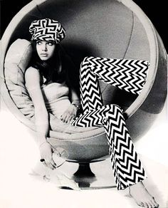 Not sure what is cooler, the round chair or the mod clothes...