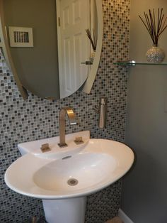 Accent wall tiled - great idea for the under the stairs half bath!