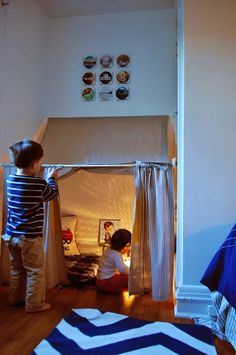 I bribed the duckling with an episode of Caillou so that I could sneak into his room and nab some more photos of his indoor tent, which ...
