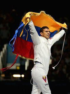 Ruben Limardo Gascon of Venezuela celebrates victory in the men's Epee Individual Fencing (Gold)