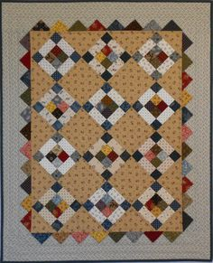 Prairie Points doll quilt, pattern in 'Remembering Adelia' by Kathleen Tracy