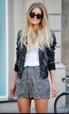 This is a white top with a mini grey skirt and leather jacket and cute black sunglasses