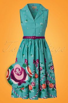 Time to dance with this 50s Matilda Folk Floral Swing Dress in Teal! Do a happy dance because Matilda simply demands one ;-) The fitted sleeveless diner style top features a V-neckline with a cute lapel collar and a row of buttons. The detachable purple fabric belt will emphasize your waist perfectly and finishes it off completely. From the waist down she runs into a flattering swing skirt with handy side pockets. Made from a breezy teal blue cotton blend with a light stretch featuring pink…