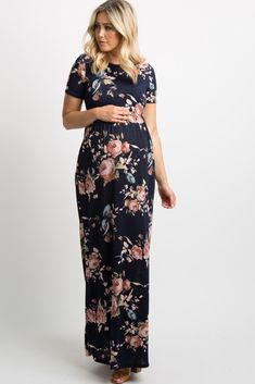 Navy Blue Rose Print Short Sleeve Maxi Dress A navy rose print maternity dress featuring a rounded neckline, short sleeves, a cinched elastic waistline, side pockets and a maxi silhouette. This style was created to be worn before, during, and after pregnancy.