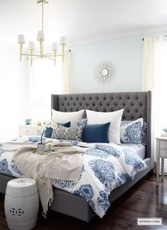 Gorgeous blue and white bedroom featuring blue and white bedding paired with global inspired textiles, grey upholstered bed and brass accents and lighting bring a bright and airy look to any bedroom. Blue and Gray Bedroom Blue Master Bedroom, Blue Bedroom Decor, Master Bedroom Design, Master Bedrooms, Bedroom Designs, Bedroom Colors, Master Suite, Bedding Decor, Modern Bedroom