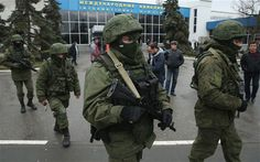 """Russian troops and gunmen in unmarked uniforms fan out across Crimea, seizing two airports in an apparent bid to assert dominance over the region. President Obama warns Russia there would be """"costs for any military intervention. Ukraine News, Military Intervention, Vietnam War Photos, Al Jazeera, Russian Federation, Latest World News, Troops, Soldiers, Obama"""