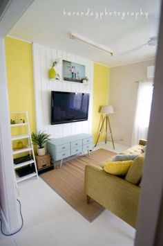 vertical planked accent wall to mount tv and hide cords. Love this idea!