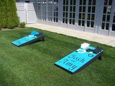Play wedding lawn games with a custom cornhole platform | Offbeat Bride