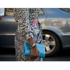 Black and white print trench with neon pink belt and patent blue clutch