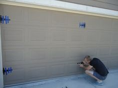 """Dressing up your 'plain' garage doors with pretty hinges and handles in what ever style you choose. This blogger used 'Liquid Nails' instead of drilling all those holes {so far she states they have stayed put, but I'm thinking 'holes""""!}"""
