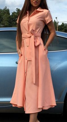 This pink dress is styled for the profession in mind with its button-down front and turn down collar. See more amazing items atFichic.com!