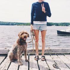 Ripped jean shorts, blue sweater, black birks
