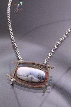 Snowy Butte from Kathleen Krucoff's Treescapes Series.  Dendritic opal set in sterling silver
