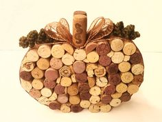 Janice, Jenny or Lori - You could easily make this and would be a fun Halloween/Thanksgiving decoration!!Fall Table Decoration  Wine Cork Pumpkin or by StickACorkInIt, $28.00