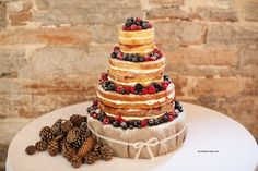 Autumn berries naked cake for a sunny October wedding.