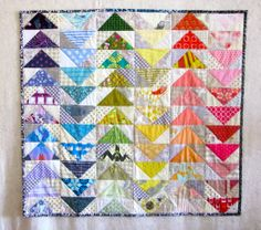 Rainbow scraps flying geese quilt