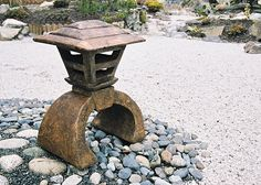 Japanese Lantern - Mashikaku. Stained ornamental concrete statue for Japanese garden or outdoor patio .