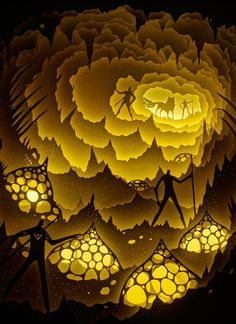 """A Mumbai-based paper art duo, going by the name Hari & Deepti, are well known for their intricate and beautiful dioramas. Their latest is a series of backlit light boxes which tell magical tales of mythical beasts interacting with humans. The series, called """"We Are All Made of Stars"""", is currently being featured in Oslo's BlankSpace Gallery, where a darkened room awaits audiences as they journey to unimaginable vistas crafted by Hari & Deepti."""