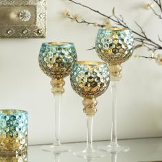 The mixture of warm earth tones and bright metallic design makes these Blue & Brown Mercury Glass Charismas perfect for the fall. The candle holders in this set are three different heights to add some complexity and depth to your home decor!