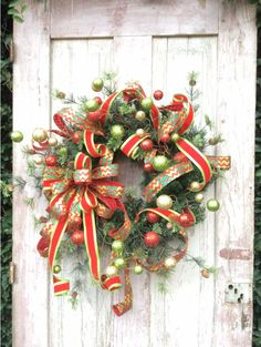 This will surely make you feel the spirit of Christmas and making memories to last a lifetime. Beautiful greens set the backdrop for a lovely glittery combination. My favorite is the fun curly ribbons