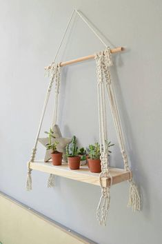 Hanging macrame shelf are so all around and very decorative. The yarn creates lovely, geometric and modern shaped home decor. Can hang from wall or ceiling Made with cotton rope and recycled pine Board, cut and sanded by hand!!! 100% handmade Board measures: 50cmX15cm, 19.5X5.9 Height: