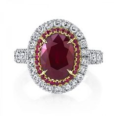 5 carat Ruby surrounded by rubies and diamonds