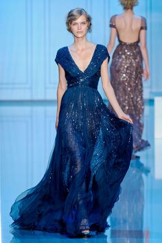 Who designed this blue beaded gown?It looks like it could be part of the Elie Saab or Oscar de la Renta collection