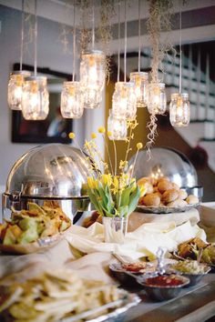 I love the mason jars. I want to but wedding pictures from my guest in the jasr and hang them over the gift table since it is a vintage theme table:)