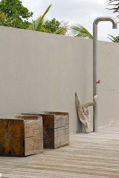 outdoor shower. Wooden block seats