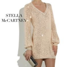 """Stella McCartney Sequined Sweater dress Stella McCartney takes this classic sweater dress and makes it perfect with shimmering sequin embellishments. This dress features silver sequins, a V-neck, full balloon sleeves that taper at the wrist, a ribbed trim and styles to slip on. Wear Stella McCartney's mini knitted style with bare legs and towering heels, then cover up with denim for cocktail hour. Size 4 Approx. Measurements: B 33-35"""", W 29"""", H 38"""", L 36"""" Material: 75% Cotton 25% Polyester…"""