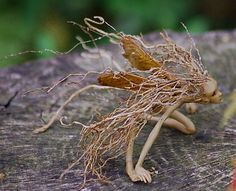 Love this artist's work! Makes me want to go carve a bunch of little root faeries and set them all around the garden.
