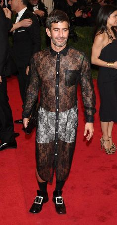 Marc Jacobs in a sheer, black lace shirt-dress and white boxer shorts for the 2012 Met Gala.