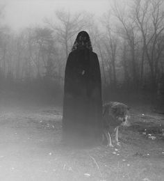 Woman black white spooky eerie ethereal solitary goth gothic mysterious nature haunting atmospheric wolf
