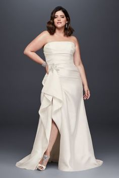 So stunning! This plus-size mikado sheath wedding gown is flatteringly ruched through the bodice and features a dramatic slit on the slim skirt. A glittering crystal brooch at the hip provides dazzling detail. Galina Signature, exclusively at David's Bridal Plus size Polyester Chapel train Back zipper; fully lined Dry clean Imported Also available in regular and extra length