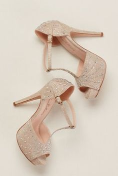 A T-strap, open toe, comfortable platform and gorgeous rhinestone embellishments forms the silhouette of these must have party heels.