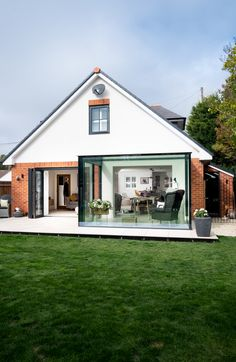 At this property minimal windows were installed to one side for ventilation and access to the patio and garden. Garden Room Extensions, Kitchen Extensions, House Extensions, Glass Extension, Extension Ideas, Glass Conservatory, Adams Homes, Open Plan Kitchen Living Room, Sliding Door Systems