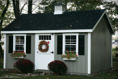 Shed Plans Grey with black shutters Now You Can Build ANY Shed In A Weekend Even If You've Zero Woodworking Experience! Pool Shed, Backyard Sheds, Outdoor Sheds, Garden Sheds, White Siding, Black Shutters, Backyard Storage, Shed Storage, Shed Colours