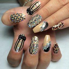 B. stilleto. Beige, black, leopard print, lace, and bling stilleto mani.