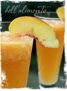 Classic Frozen Peach Bellini.  Crush ice first while microwaving frozen peaches. Then add all ingredients and blend until smooth.