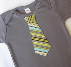 Cute idea--take a plain onesie and sew on different fabric patterns of ties!
